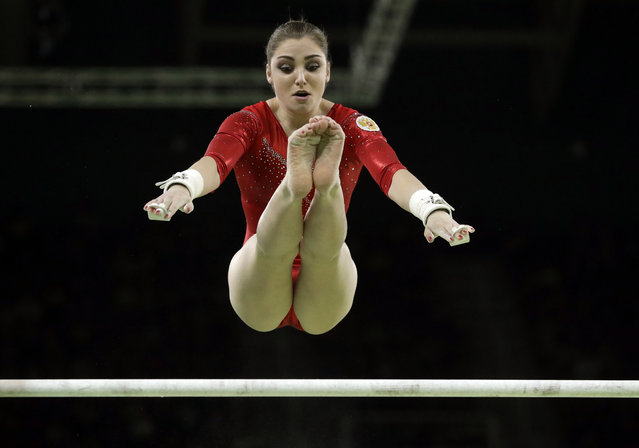 Russia's Aliya Mustafina performs on the uneven bars during the artistic gymnastics women's apparatus final at the 2016 Summer Olympics in Rio de Janeiro, Brazil, Sunday, August 14, 2016. (Photo by Dmitri Lovetsky/AP Photo)