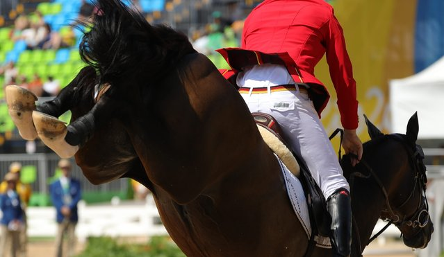Christian Ahlmann of Germany riding Taloubet Z performs during the Jumping Individual 3rd qualifier competition of the Rio 2016 Olympic Games Equestrian events at the Olympic Equestrian Centre in Rio de Janeiro, Brazil, 17 August 2016. (Photo by Armando Babani/EPA)