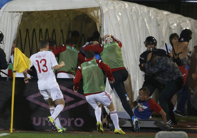 Albania's players retreat into the tunnel during their Euro 2016 Group I qualifying soccer match against Serbia at the FK Partizan stadium in Belgrade October 14, 2014. (Photo by Marko Djurica/Reuters)