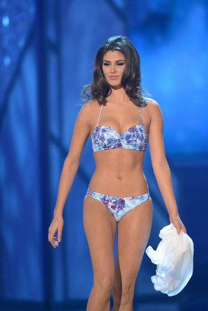 Miss Mexico, Karina Gonzalez, walks on stage during the Miss Universe Pageant at Planet Hollywood in Las Vegas, Nevada on December 19, 2012.  Miss USA, Olivia Culpo was crowned Miss Universe 2012,  beating out beauties from around the world to claim the coveted title.  The title of first runner-up title went to the contestant from the Philippines, Janine Tugonon. (Photo by Joe Klamar/AFP Photo)