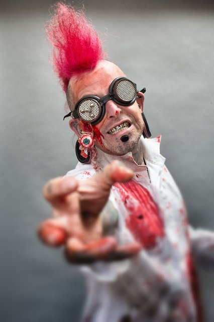 Sword swallower Hannibal Hellmurto poses for a photograph prior to a rehearsal of the Circus of Horrors' latest show The Night of the Zombie at the Wookey Hole Caves Theatre near Wells on October 23, 2014 in Somerset, England. (Photo by Matt Cardy/Getty Images)