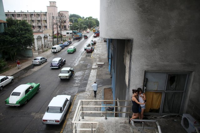 Girls use the internet to communicate at a Wi-Fi hotspot in Havana, September 22, 2015. Cuba's new Wi-Fi hotspots – 35 nationwide since July with more promised soon – are a sensation in a highly-controlled country with one of the world's lowest Internet penetrations. (Photo by Alexandre Meneghini/Reuters)