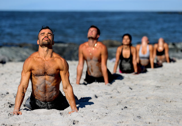 Dennis Guerrero and members of the Jetty Fitness Club train at the beach on August 18, 2020 in Long Beach, New York. Gyms, which have been closed in New York since mid-March to help prevent the spread of the coronavirus, will be allowed to open again as soon as August 24th Governor Andrew Cuomo has announced. Gyms will be limited to a third of their capacity, and they need to maintain a sign-in sheet to help contact tracers in case of a virus outbreak. Air filters must be able to help prevent the transmission of viral particles. People must wear masks at all times (Photo by Al Bello/Getty Images)