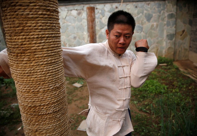 "Kung Fu master Xing Xi practices at his Kung Fu academy ""Kung Fu Zen"" in Beijing, China, June 29, 2016. (Photo by Kim Kyung-Hoon/Reuters)"