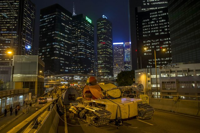 An art installation by a local artist made with umbrellas, tents and metals in the shape of a tank is seen on a blocked road during the Occupy Central civil disobedience movement in Hong Kong November 11, 2014. Hong Kong's acting chief executive on Tuesday called on pro-democracy protesters to clear sites they have occupied for more than six weeks and warned holdouts they could face arrest, a move that could swell protest numbers. (Photo by Tyrone Siu/Reuters)