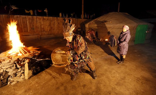 Shamans (L front, L back, R back), representing the so-called Adyg Eeren (Bear Spirit) society, participate in the so-called Kamlanie night ritual upon the request of customers, including local residents and foreigners, in the town of Kyzyl, the administrative centre of Tuva region, Southern Siberia, Russia, October 9, 2015. (Photo by Ilya Naymushin/Reuters)