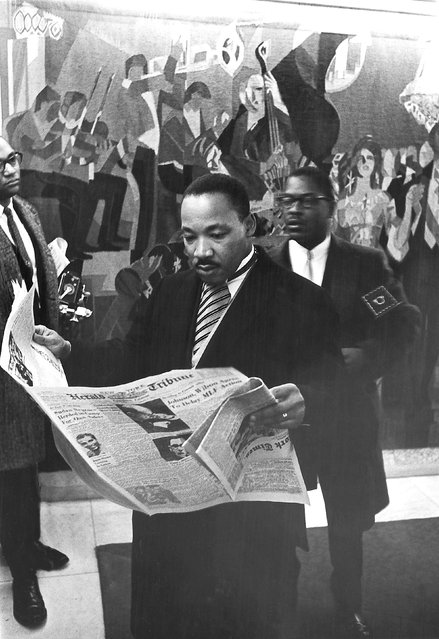 Martin Luther King Jr. reads the newspaper as he prepares to  accept his Nobel Prize Award in 1964, in this handout image provided by the Ebony Collection. Johnson Publishing, parent company of struggling Ebony and Jet magazines, is seeking a buyer for the archive, which it estimates is worth more than $40 million. (Photo by Moneta Sleet Jr./Reuters/Johnson Publishing Co./Ebony Collection)