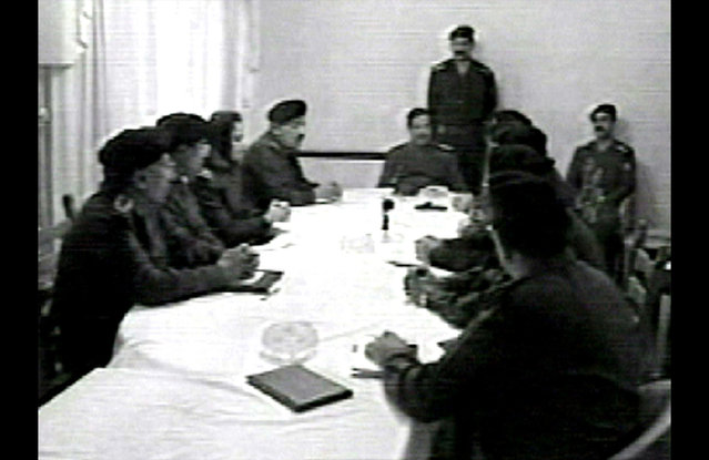 In this image from video seen on Iraqi television on March 27, 2003, Iraqi President Saddam Hussein meets with high-ranking Ba'ath party officials. (Photo by AP Photo/Iraqi TV/APTN/The Atlantic)