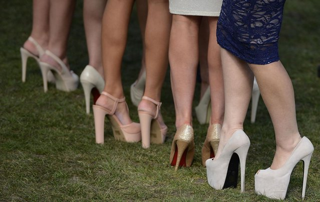Racegoers shoes are seen as they arrive for the second day of the Grand National meeting at Aintree, northern England April 5, 2013. (Photo by Nigel Roddis/Reuters)