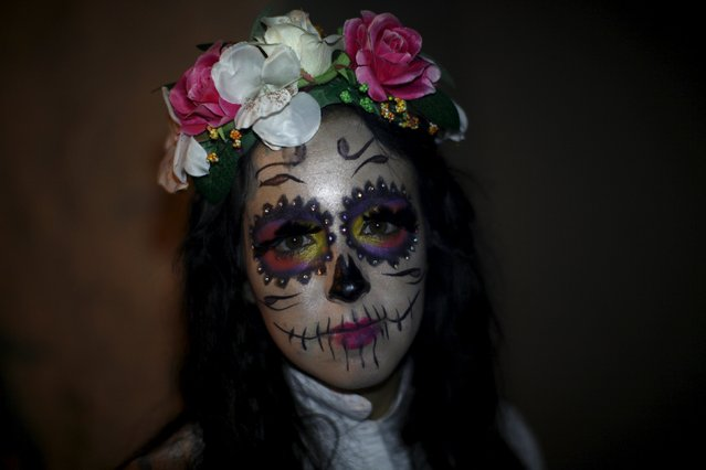 """A woman dressed as the character of Corpse Bride from the movie """"Corpse Bride"""" poses for a photo as she takes part in the second edition of """"Noche del Terror"""" (Horror night) during Halloween celebrations in the neighborhood of Churriana, near Malaga, southern Spain, October 31, 2015. (Photo by Jon Nazca/Reuters)"""