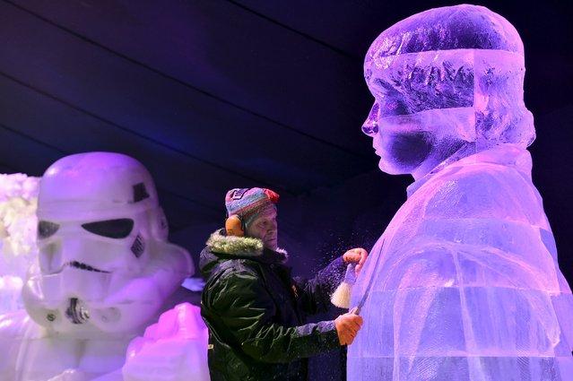 Czech's Jiri Genzer carves Star Wars character Luke Skywalker for the ice sculpture festival in Liege, Belgium, November 13, 2015. (Photo by Eric Vidal/Reuters)