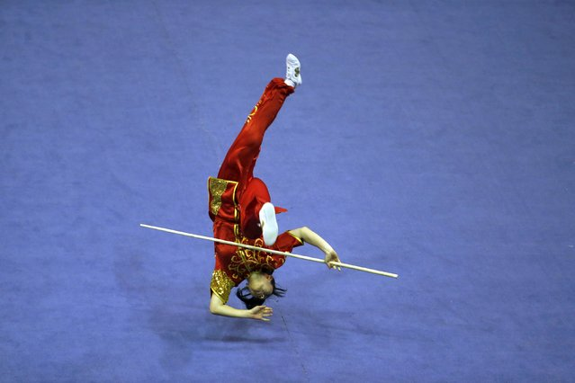 Australia's Jessica Lim competes in the women's nangun final during the 13th World Wushu Championship 2015 at Istora Senayan stadium in Jakarta, November 17, 2015. (Photo by Reuters/Beawiharta)