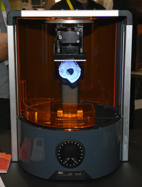 Autodesk's Ember 3D stereo lithography 3D printer is displayed at the 2015 International CES at the Sands Expo and Convention Center on January 6, 2015 in Las Vegas, Nevada. The printer uses the Spark open 3D printing platform and a UV curable resin that hardens with light and will be available later this year for USD 5,995. (Photo by Ethan Miller/Getty Images)