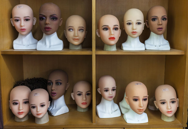 "Heads of the ""smart"" s*x dolls on display in dolls factory in Dongguan, Guandong Province, China, 24 April 2018. (Photo by Aleksandar Plavevski/EPA/EFE)"