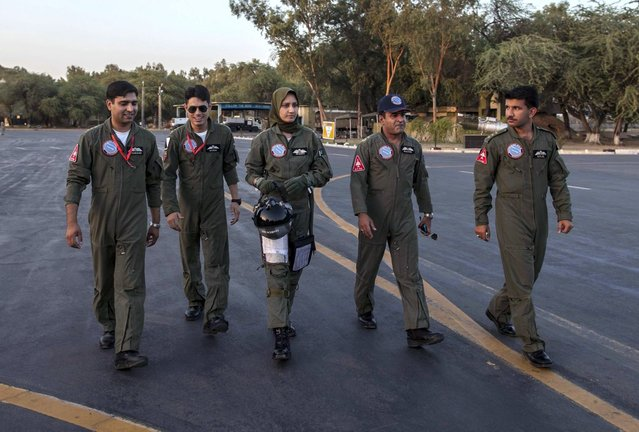 Ayesha Farooq, 26, (C) Pakistan's only female war-ready fighter pilot, walks with Wing Commander of Squadron 20 Nasim Abbas (2nd R) and her colleagues toward a Chinese-made F-7PG fighter jet at Mushaf base in Sargodha, north Pakistan June 6, 2013. (Photo by Zohra Bensemra/Reuters)