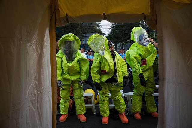 Firefighters participate in an anti-terror and chemical drill at the Rizal Park ahead of the papal visit to the area on January 14, 2015 in Manila, Philippines. Pope Francis will visit venues across Leyte and Manila during his visit to the Philippines from January 15 – 19. (Photo by Lam Yik Fei/Getty Images)