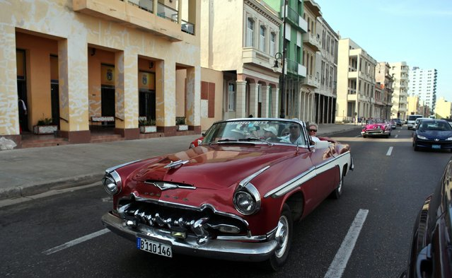 Tourist are driven through the streets in vintage cars, on the eve of the 28th round of the Cuba-US migratory talks, in Havana, Cuba, 20 January 2015. The historical normalization course of the relations between Cuba and the United States this week will be full of symbols: the arrival in Havana of an envoy of the highest level US in decades and the State of the Union speech by President Barack Obama to explain his unprecedented twist in this subject. (Photo by Alejandro Ernesto/EPA)