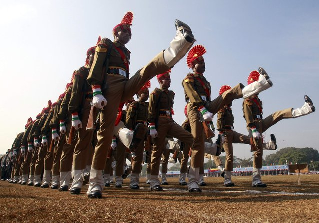 India's Border Security Force (BSF) soldiers march during a Republic Day parade in the northeastern Indian city of Agartala January 26, 2015. India celebrated its 66th Republic Day on Monday. (Photo by Jayanta Dey/Reuters)