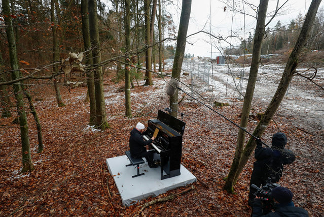 Pianist Igor Levit plays the piano during a protest action against the extension of the A49 motorway, near Dannenrod, Germany, December 4, 2020. (Photo by Kai Pfaffenbach/Reuters)