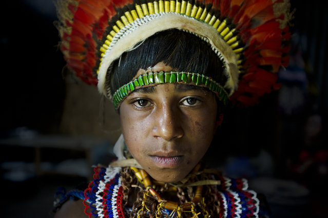 """Vegu Nagamiufa"". Vegu, a member of the Nagamiufa tribe, in the Eastern Highlands of Papua New Guinea wearing traditional ""bilas"". Her grandfather recieves a small living allowance from the government for his work preserving traditional costumes of tribal groups in the highlands. (Photo and caption by James Morgan/National Geographic Traveler Photo Contest)"