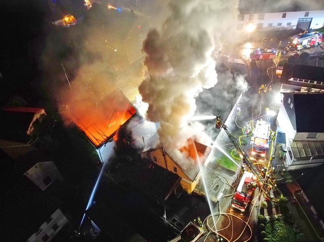 The fire department extinguishes two burning houses in the centre of Unterjeckenbach, Rhineland-Palatinate, Germany on December 4, 2020. A barn fire in Unterjeckenbach keeps the fire brigade busy on Friday morning. The exact background of the fire was initially unclear. (Photo by Sebastian Schmitt/picture alliance via Getty Images)