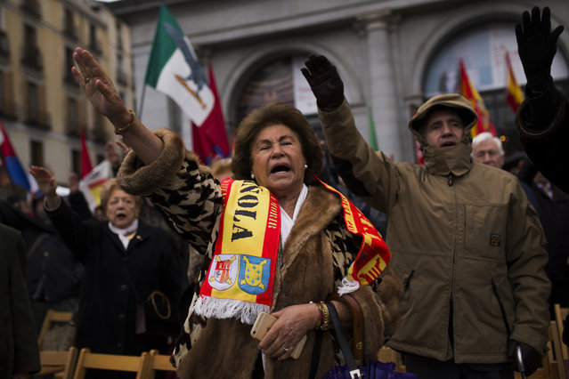 Fascists and extreme far right wing supporters gesture,  during a rally commemorating former Spanish dictator Francisco Franco's death in Madrid, Sunday, November 20, 2016. Hundreds of Spaniards nostalgic for the nation's fascist dictatorship gathered in a Madrid square on Sunday to commemorate the 41st anniversary of Francisco Franco's death. (Photo by Francisco Seco/AP Photo)