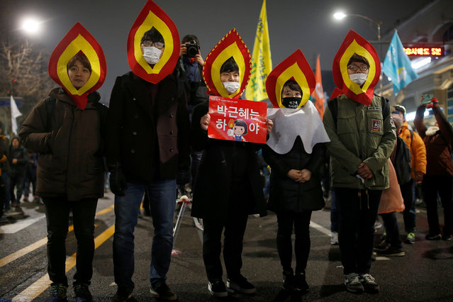 "People attend a protest calling for Park Geun-hye to step down on a road leading to the Presidential Blue House in central Seoul, South Korea, November 26, 2016. The signs read ""Step down Park Geun-hye"". (Photo by Kim Kyung-Hoon/Reuters)"