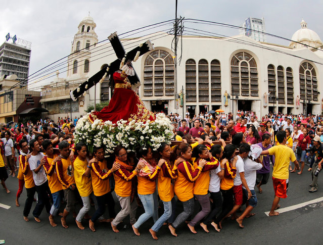 Filipino barefoot Catholics carry a replica of the Black Nazarene during a procession ahead of the Black Nazarene feast day celebrations in Manila, Philippines, 07 January 2016. The procession of the Black Nazarene is expected to draw millions of barefooted Catholic devotees to Manila on 09 January, according to a Manila police official. (Photo by Francis R. Malasig/EPA)
