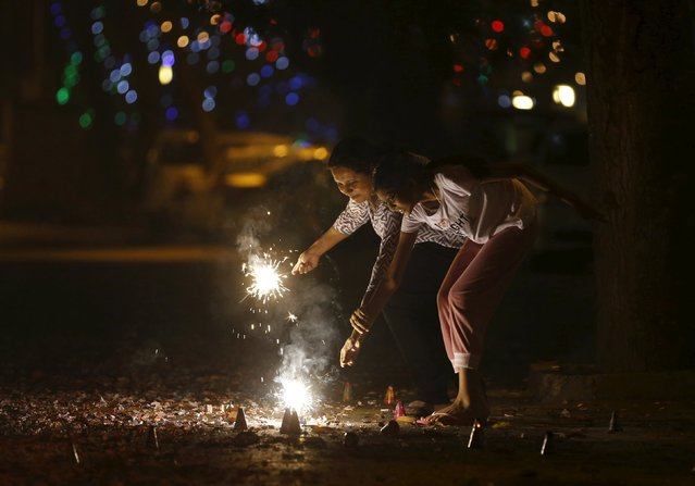 Residents light firecrackers on the street during the New Year celebrations in Mumbai, India, January 1, 2016. (Photo by Danish Siddiqui/Reuters)