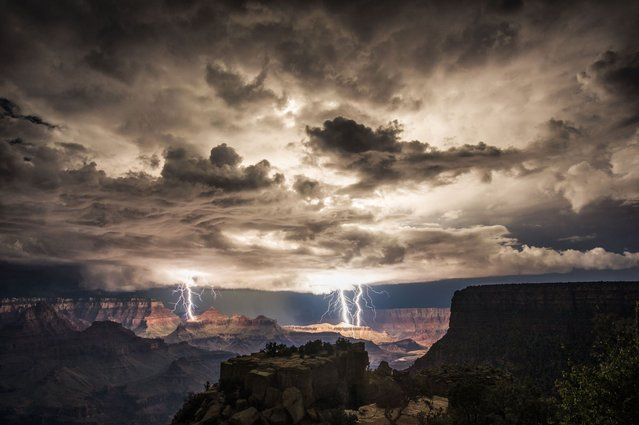 Using clever low exposure techinques, photographer Rolf Maeder managed to capture multiple strikes hitting the canyon under atmospheric stormy skies. (Photo by Rolf Maeder)