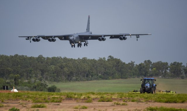 """A U.S. Air Force B-52 Stratofortress bomber, assigned to the 96th Expeditionary Bomb Squadron, deployed from Barksdale Air Force Base, Louisiana, lands during exercise Lightning Focus at Royal Australian Air Force Base (RAAF) in Darwin, Australia, December 6, 2018. The U.S. Air Force flew three B-1 heavy bombers over the East Siberian Sea, north of Russia's far east, as part of recent maneuvers that the military said Friday are meant to demonstration of American capabilities and ability to support allies, but which a Russian commander blasted as """"hostile and provocative"""". The flight of the three Texas-based U.S. Air Force Reserve B-1 Lancer bombers on Thursday followed a similar mission a week ago in which three temporarily Britain-based B-52 bombers were flown over Ukrainian airspace, near Russia's western flank. (Photo by U.S. Air Force photo by Senior Airman Christopher Quail via AP Photo)"""