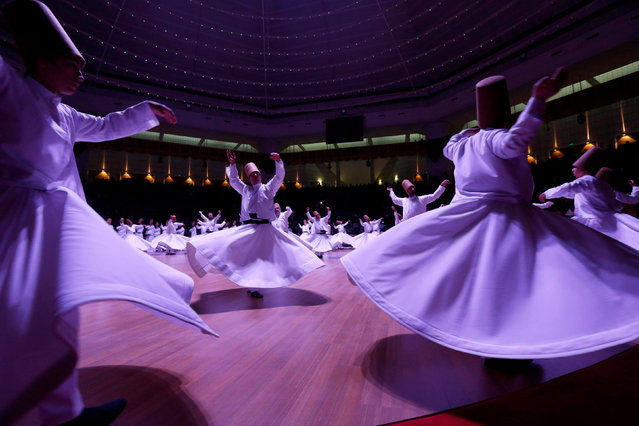 """Whirling dervishes perform a traditional """"Sema"""" ritual during a ceremony, one of many marking the 743rd anniversary of the death of Mevlana Jalaluddin Rumi, at Mevlana Cultural Center in Konya, Turkey, December 7, 2016. (Photo by Murad Sezer/Reuters)"""