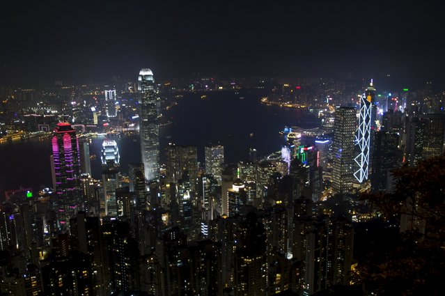 Commercial towers light up by Power Assets, which provides electricity to Hong Kong island, are seen from the Peak in Hong Kong, China September 8, 2015. (Photo by Tyrone Siu/Reuters)