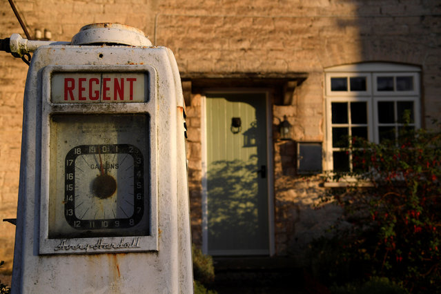 An old petrol pump is seen at the entrance to a house in a village near Stroud in the Cotswolds, Britain October 11, 2016. (Photo by Toby Melville/Reuters)