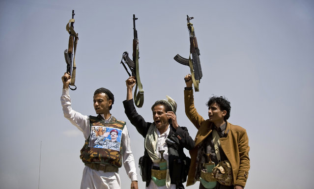 Supporters of Ahmed Ali Abdullah Saleh, the son of Yemeni former President Ali Abdullah Saleh, hold their weapons as they chant slogans during a demonstration demanding presidential elections be held and the younger Saleh run for the office, in Sanaa, Yemen, Tuesday, March 10, 2015. (AP Photo/Hani Mohammed)