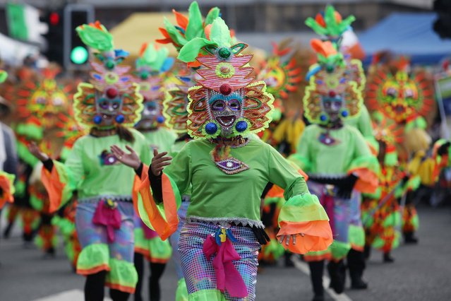 Members of Filipino Cork Community dancing at St Patrick's Day Parade Cork City and Lord Mayor of Cork on March 17, 2015. (Photo by Clare Keogh)