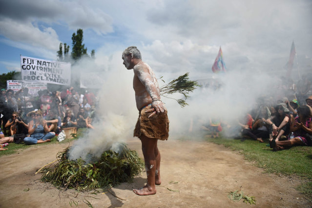 A smoking ceremony is conducted during an Aboriginal protest at the Tent Embassy on the lawns of Old Parliament House in Canberra, Australia, 26 January  2016. The annual official National Day of Australia marks the anniversary of the British First Fleet's arrival at Port Jackson, New South Wales, in 1788. (Photo by Mick Tsikas/EPA)
