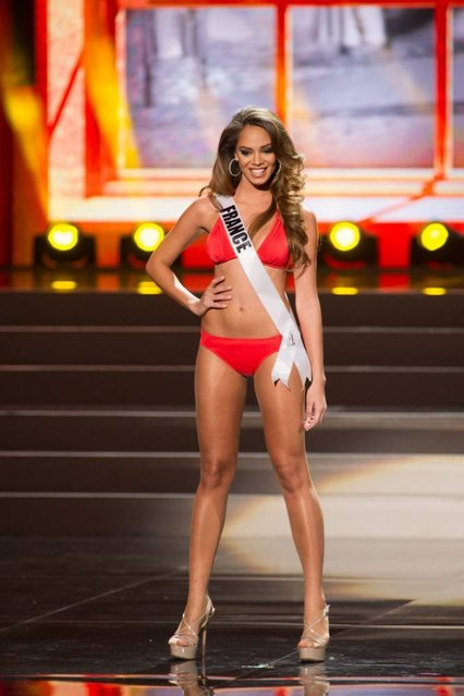 A handout picture provided by the Miss Universe Organization shows Hinarani de Longeaux, Miss France 2013, competing in the swimsuit competition during the Preliminary Competition at the Crocus City Hall, in Moscow, Russia, 05 November 2013. (Photo by Darren Decker/EPA)