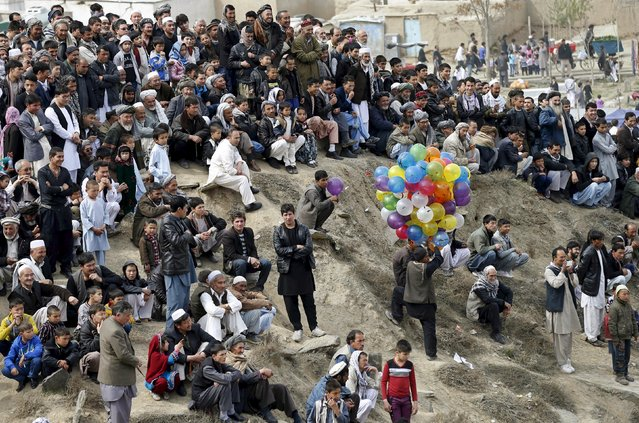 People gather near a shrine to celebrate the Afghan New Year (Newroz) in Kabul March 21, 2015. (Photo by Mohammad Ismail/Reuters)