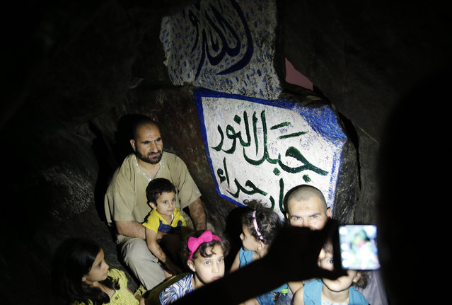 "Muslims take a picture at the Hera cave in Mount Al-Noor during their Umrah ""Mawlid al-Nabawi"" or ""Birthday of Prophet Mohammad"" in the holy city of Mecca, Saudi Arabia January 16, 2016. (Photo by Amr Abdallah Dalsh/Reuters)"