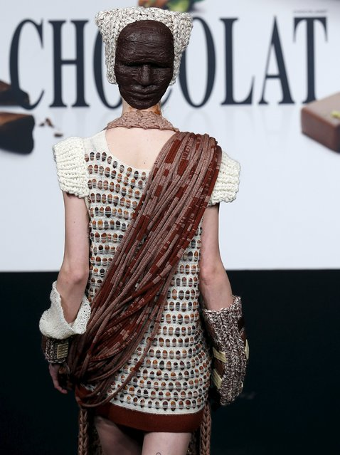 "A model dressed in an outfit made with chocolate presents a creation at the Brussels ""Le Salon du Chocolat"" chocolate fair February 5, 2016. (Photo by Yves Herman/Reuters)"