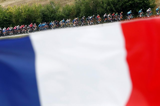 It's a flag day for the peloton on stage 17 of the Tour de France, a 111-mile mountain ride from Muret to St-Lary-Soulan Col du Portet, France on July 14, 2021. (Photo by Stephane Mahe/Reuters)