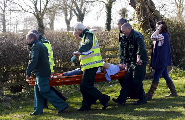 An injured player is stretchered to an ambulance during the bottle-kicking game in Hallaton, central England April 6, 2015. (Photo by Darren Staples/Reuters)
