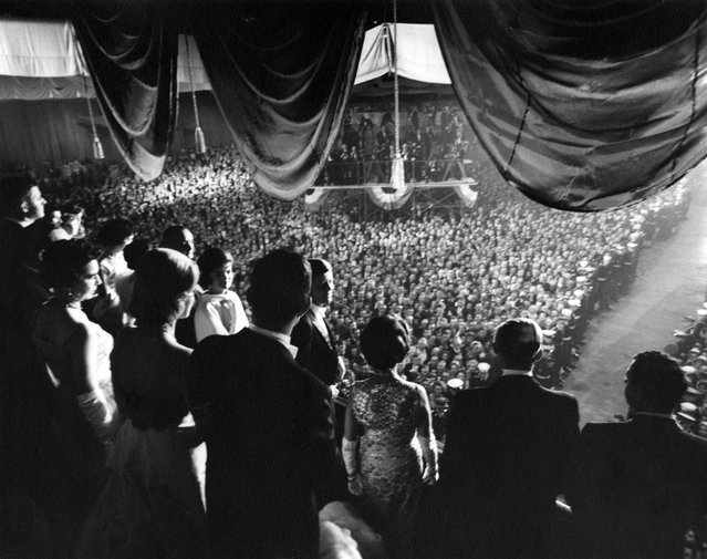 John F. Kennedy and party at the inaugural ball in Washington, D.C., U.S. in January 1961. Alongside the new president are Vice President Lyndon B. Johnson, Jacqueline Kennedy, Ted Kennedy and his wife Joan, and Kennedy's parents Joseph P. and Rose Fitzgerald Kennedy. (Photo by Abbie Rowe/Reuters/White House Photo/John F. Kennedy Presidential Library & Museum)