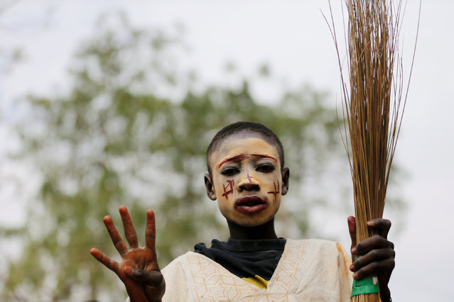 A boy participates in celebrations by supporters of Nigeria's President Muhammadu Buhari in Kano, Nigeria February 27, 2019. (Photo by Afolabi Sotunde/Reuters)