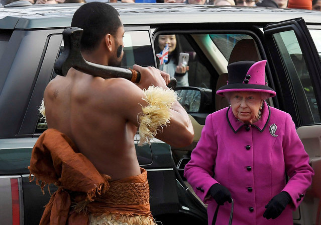 Britain's Queen Elizabeth looks towards a man dressed in traditional costume as she arrives to view an exhibition on Fiji at the Sainsbury Centre for Visual Arts, University of East Anglia in Norwich, eastern England, January 27, 2017. (Photo by Toby Melville/Reuters)