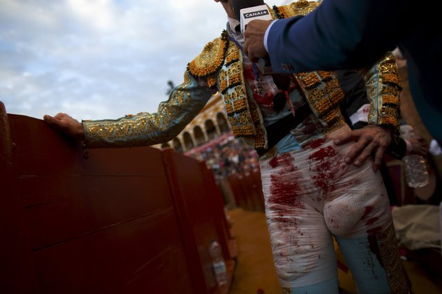 Spanish matador Juan Jose Padilla is interviewed by a TV reporter after killing a bull during a bullfight at The Maestranza bullring in the Andalusian capital of Seville, southern Spain April 25, 2015. (Photo by Marcelo del Pozo/Reuters)