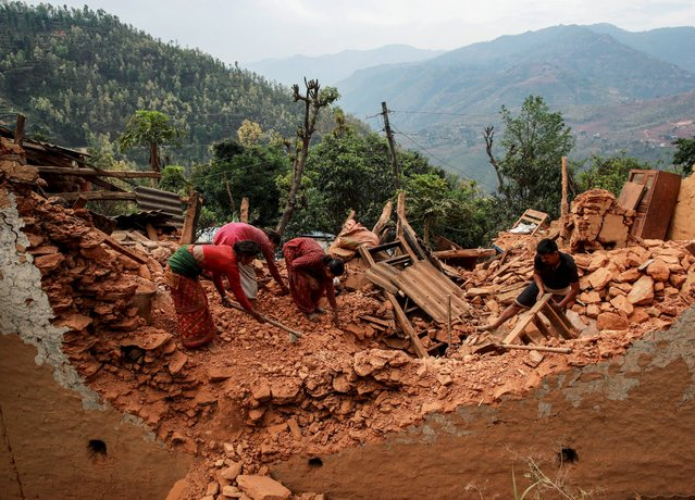 Residents try to salvage their belongings from the debris of their house at a village following Saturday's earthquake in Sindhupalchowk, Nepal, April 28, 2015. (Photo by Danish Siddiqui/Reuters)