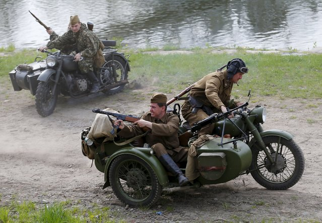 Enthusiasts take part in an re-enactment battle between the Soviet Red Army and German troops during the 70th anniversary of the liberation of Ostrava, in Ostrava, Czech Republic, April 30, 2015. (Photo by Laszlo Balogh/Reuters)