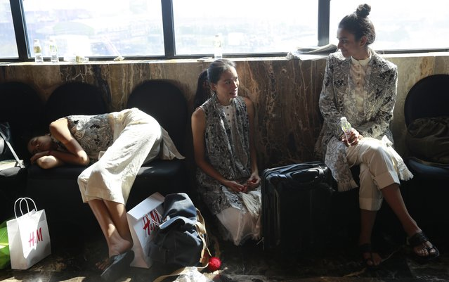 In this January 30, 2017 photo, Anjali Lama, a transgender model from Nepal, speaks with another model during a trial event for Lakme Fashion week in Mumbai, India. Growing up as the fifth son in a poor farming family in rural Nepal the dream to be a fashion model came late in life. First came a long, painful struggle to accept that he felt deeply female. It was a chance encounter with a group of transgender women that turned Lama's life around by putting her in touch with the Blue Diamond Society, an advocacy group for Nepal's LGBT community. In 2005 she came out to her friends and family as a transgender woman. (Photo by Rafiq Maqbool/AP Photo)